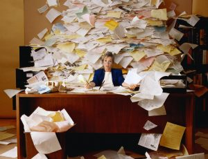 Business Woman overwhelmed with paperwork